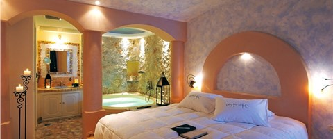 Junior Suite with indoor couples Jacuzzi and private balcony with sea/caldera/volcano view