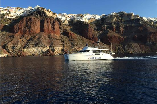 Photo of Small-Group Power Catamaran Cruise in Santorini with BBQ and Drinks
