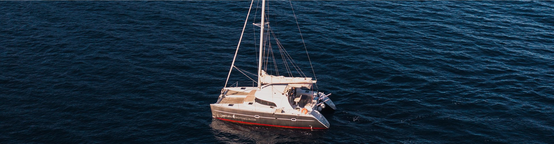 Photo of Private catamaran cruise from Oia with meal and drinks