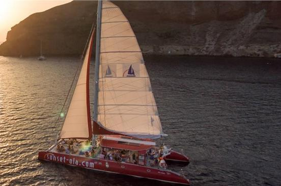 Photo of Catamaran Sunset Boat Tour in Santorini with BBQ and Drinks