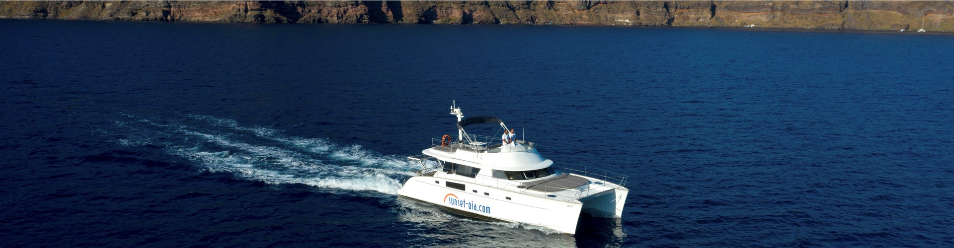 Photo of Private Power Catamaran Cruise in Santorini with BBQ and Drinks