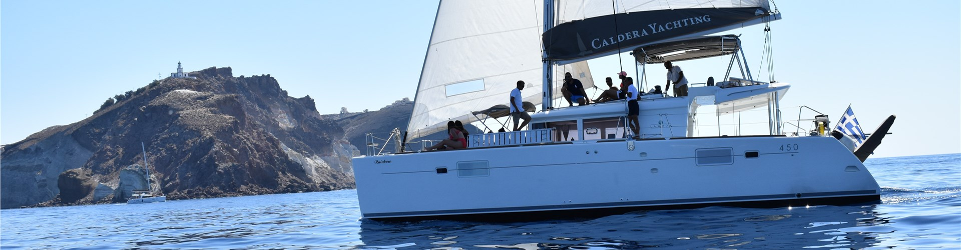 Photo of Caldera Gold Catamaran Cruise in Santorini with BBQ Meal and Drinks